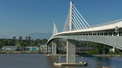 stock-footage-vancouver-canada-may-canada-line-train-passes-bridge-on-may-the-canada.jpg